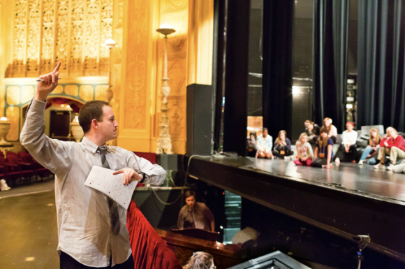"""Directing 70 youths of Detroit in """"The Happy Prince,"""" Detroit Opera House, April 2011.  Photograph by Mitch Carter"""